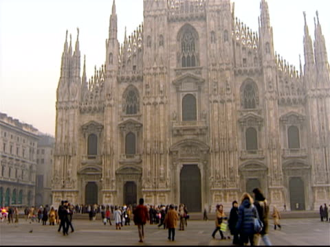 wide shot exterior of the duomo di milano in the piazza del duomo / milan, italy - piazza del duomo milan stock videos and b-roll footage