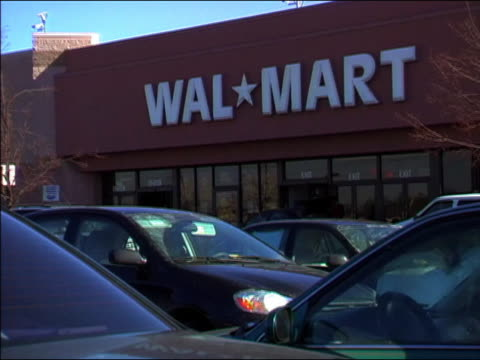 2004 wide shot exterior of wal-mart and parking lot with shoppers / maryland - megastore stock videos & royalty-free footage
