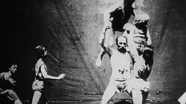 1895 wide shot family of gymnasts performing at german vaudeville show - akrobat bildbanksvideor och videomaterial från bakom kulisserna