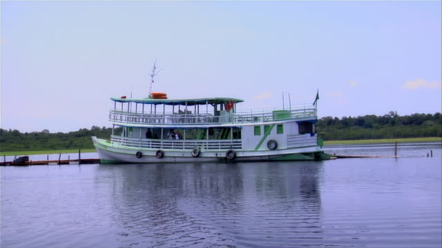 stockvideo's en b-roll-footage met wide shot ferry boat on dock in rio negro/ the amazon, brazil - color negro