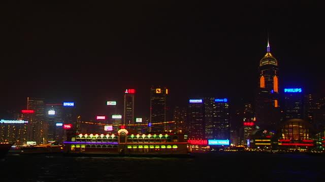 wide shot ferry passing aberdeen harbour hong kong kwangtung china - aberdeen hong kong stock videos & royalty-free footage