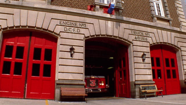 wide shot fire truck driving out of fire station / washington, d.c. - fire station stock videos & royalty-free footage