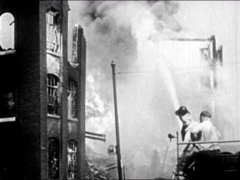 1947 wide shot firemen shooting burning building with firehose/ dearborn, michigan - dearborn michigan stock videos and b-roll footage