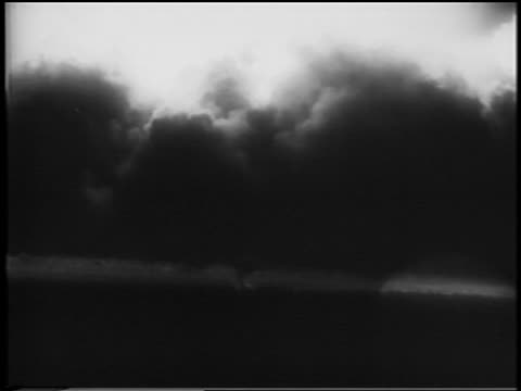 B/W 1945 wide shot first atomic bomb testing at Alamogordo New Mexico / newsreel