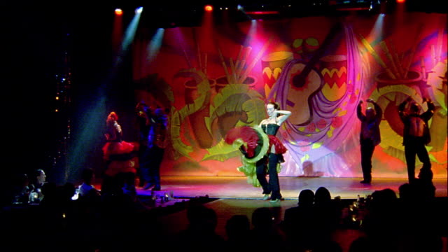 wide shot flamenco dancers in costume performing on stage with audience in foreground - showgirl stock videos and b-roll footage