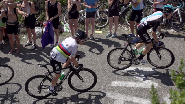 wide shot from above looking down on mark cavendish climbing during stage 10 of the 2012 tour de france - ツール・ド・フランス点の映像素材/bロール