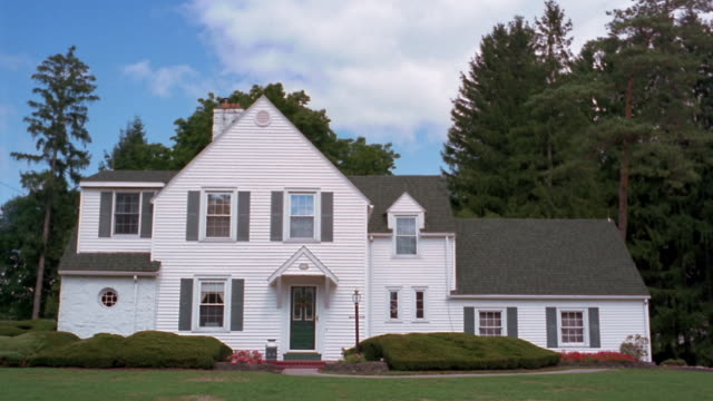 wide shot front of white suburban house in upstate new york / utica, new york - establishing shot stock videos & royalty-free footage