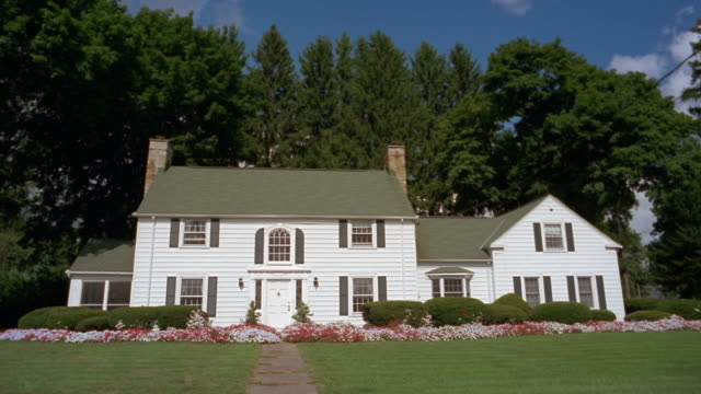 wide shot front of white suburban house in upstate new york / utica, new york - wide stock videos & royalty-free footage