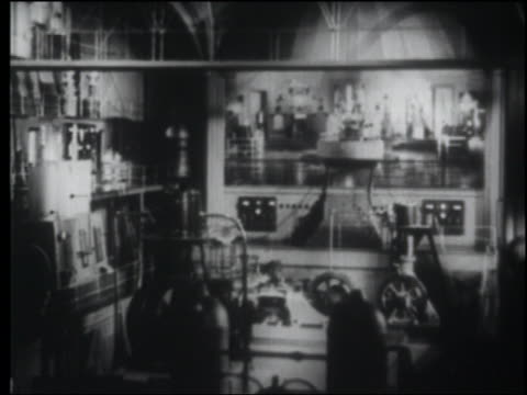 b/w 1940 wide shot futuristic control room - film industry video stock e b–roll