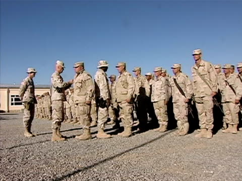 wide shot general giving soldier award medal on us military base/ afghanistan - operation enduring freedom stock videos & royalty-free footage