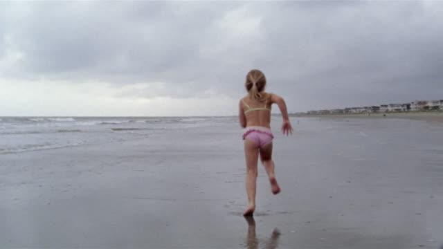 wide shot girl running on beach/ charleston, south carolina - carolina beach stock videos & royalty-free footage