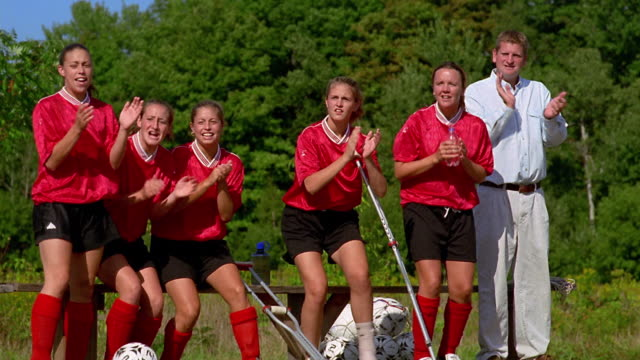 wide shot girls soccer team watching game from sidelines and cheering / vermont - amateur stock videos & royalty-free footage