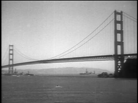 b/w 1937 wide shot golden gate bridge with ships underneath at grand opening / san francisco ca / newsreel - golden gate bridge stock videos & royalty-free footage