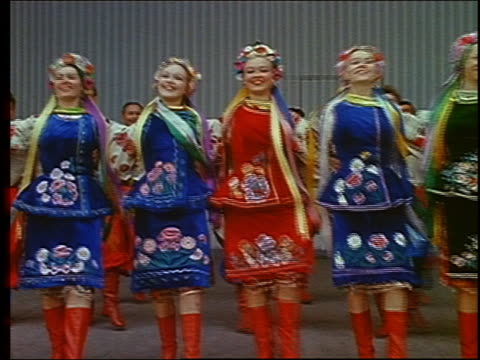 vídeos de stock e filmes b-roll de 1967 wide shot group of russian folk dancers performing / russia - rússia