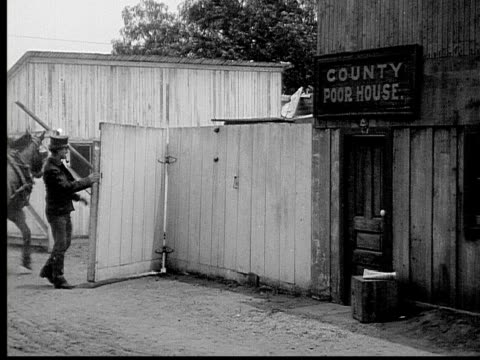 1913 b/w wide shot guard opening gate as horse cart enters county poor house grounds / usa  - 1913 stock videos & royalty-free footage