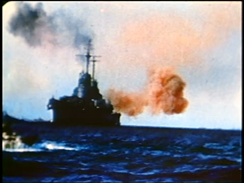 1945 wide shot guns shooting off of military ship in battle on ocean near Iwo Jima Island / documentary
