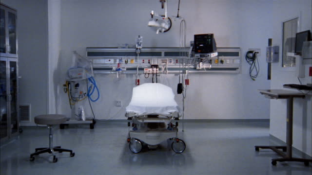 Wide shot gurney in emergency room