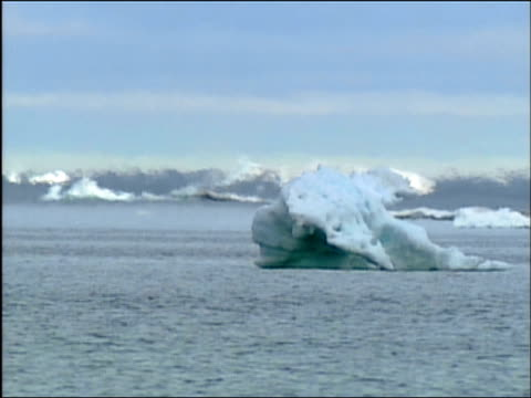 Wide shot heat haze emanating from icebergs in Arctic Ocean / Alaska