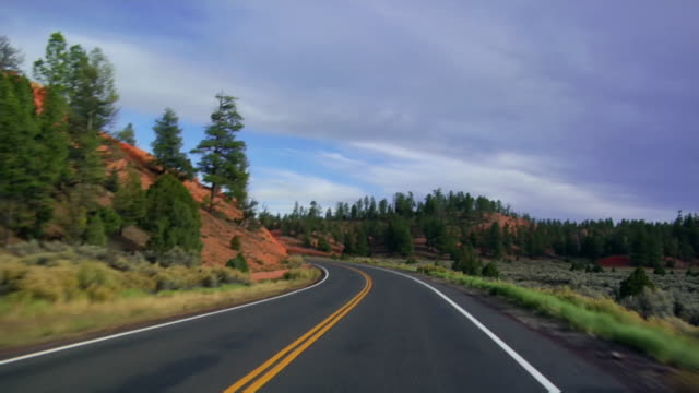 Wide shot Highway winding through Red Canyon/ Utah, USA