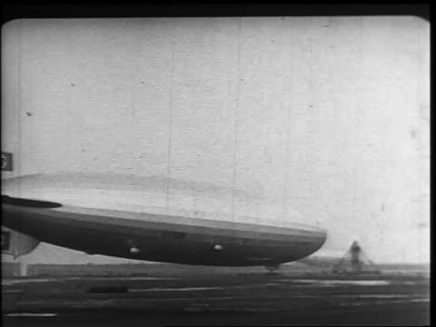 b/w 1937 wide shot hindenburg landing mooring at lakehurst new jersey - 1937 stock videos and b-roll footage