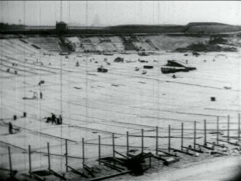 b/w 1934 wide shot huge basin in reservoir construction in wpa project / atlantic city nj / documentary - 雇用促進局点の映像素材/bロール