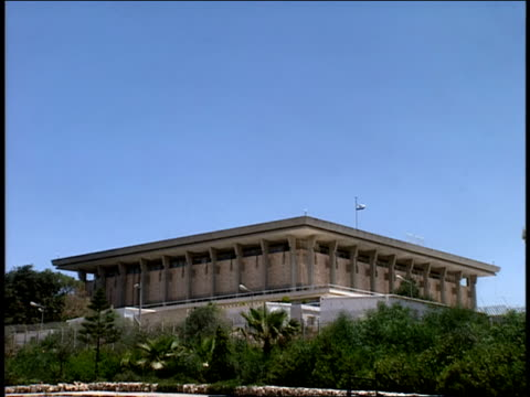 2006 Wide shot Israeli flag waving above Knesset building, house of Israel's legislature/ Jerusalem, Israel