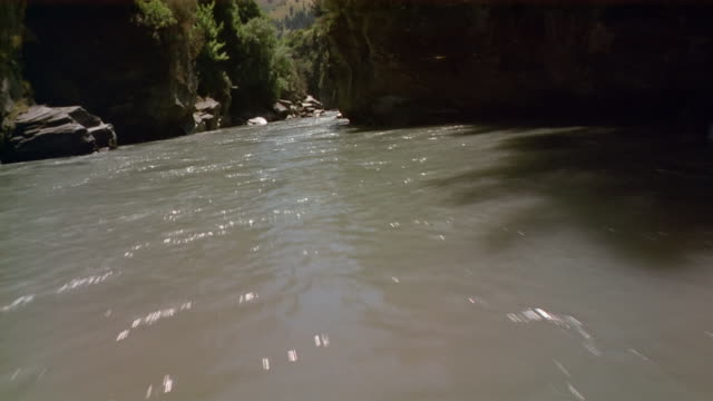 wide shot jet boat point of view speeding down river / new zealand - acquascooter video stock e b–roll