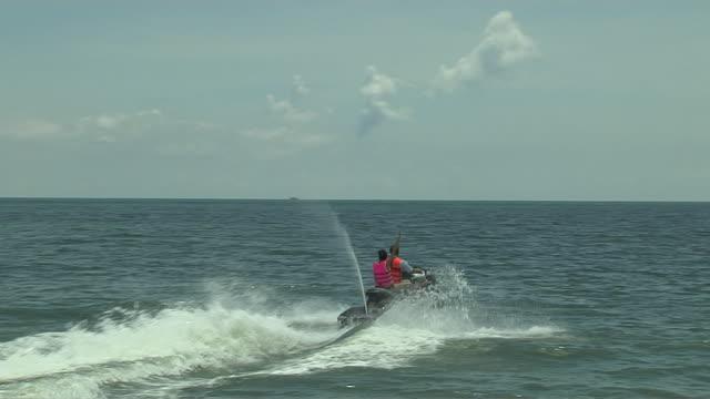 wide shot jet ski ride in sokha beach sihanoukville cambodia - acquascooter video stock e b–roll