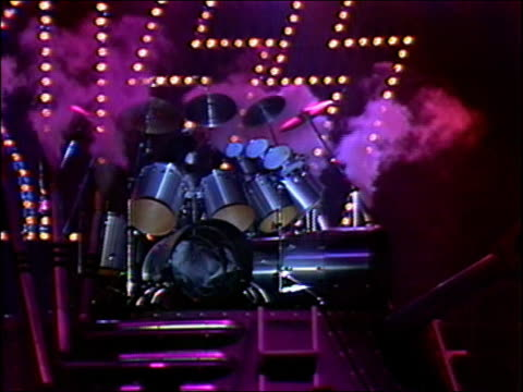 1982 wide shot kiss drummer eric carr playing huge drum kit on rotating tank stage set / audio - spandex stock videos & royalty-free footage