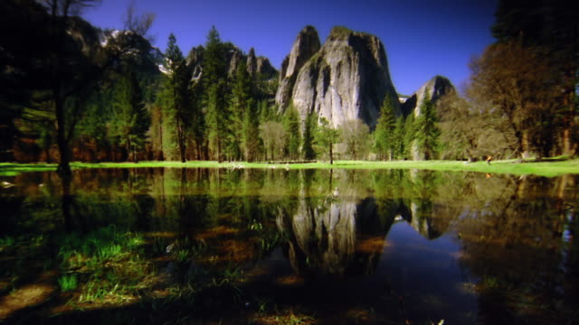wide shot lake with cathedral rocks and trees in background / yosemite national park, california - cathedral rocks stock videos & royalty-free footage