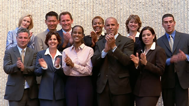 wide shot large group of business people clapping outdoors - organised group photo stock videos & royalty-free footage