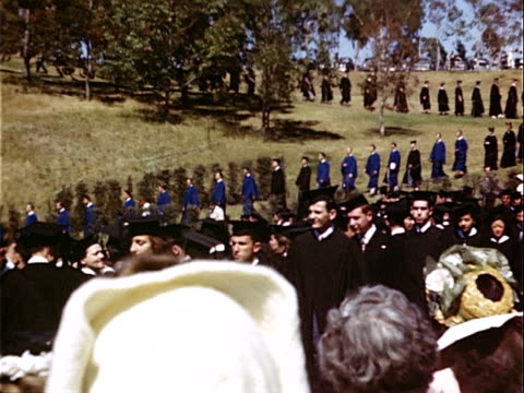 1949 wide shot large group of graduates marching down hill during graduation ceremony at university of california campus / westwood, los angeles, california, usa  - mortar board stock videos & royalty-free footage