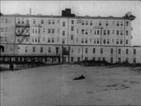 b/w 1926 wide shot large hotel on beach / long beach california / newsreel - 1926 stock videos & royalty-free footage