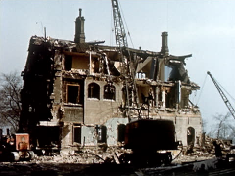 1956 wide shot large house being demolished - 1950 stock videos and b-roll footage