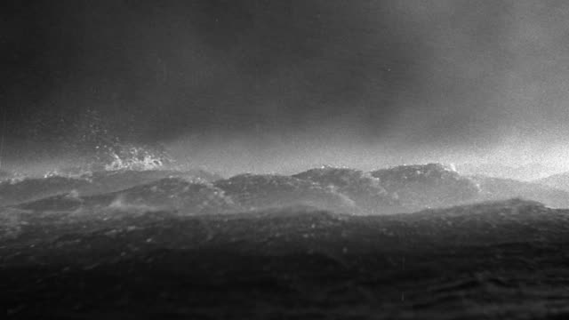 b/w wide shot large ship (model) in heavy storm + rough seas at night - rough stock videos & royalty-free footage