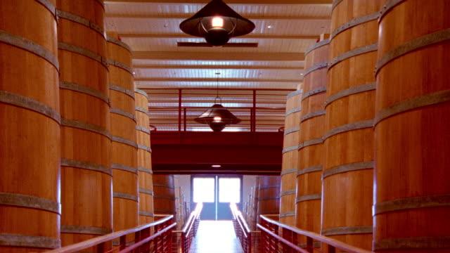 Wide shot large wine casks and doorway at Robert Mondavi Winery/ Napa Valley, California