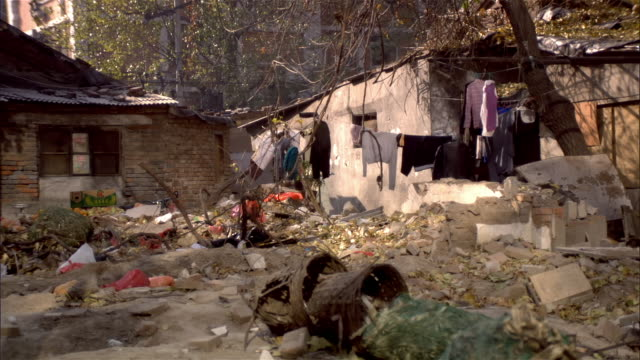 wide shot laundry hanging outside shack in slum area of city/ beijing, china - bad condition stock videos & royalty-free footage