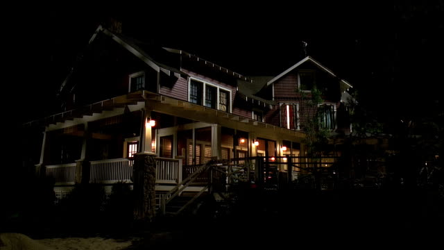 2001 wide shot light illuminating beach house at night/ grand haven, michigan, usa - veranda stock videos & royalty-free footage