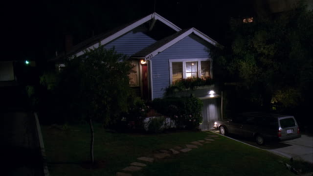 2005 wide shot light illuminating suburban house at night/ los angeles, california, usa - stationary stock videos & royalty-free footage