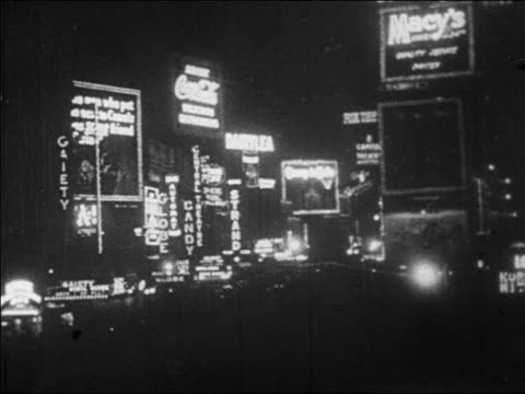 b/w 1928 wide shot lights of theatre marquees in times square at night / nyc / newsreel - 1928 stock videos & royalty-free footage