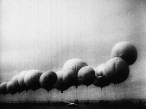 wide shot line of hot air balloons sitting on ground / russia / documentary - anno 1927 video stock e b–roll