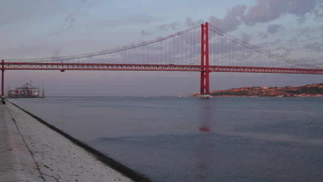 "wide shot lisbon 25 april bridge ""ponte 25 de abril"" - 1974 stock videos & royalty-free footage"