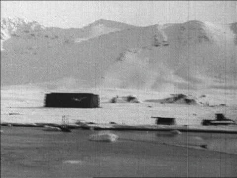 b/w 1926 wide shot long shot byrd's plane landing after flight over north pole / newsreel - 1926 stock videos & royalty-free footage