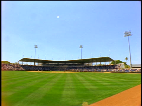 wide shot long shot from outfield of baseball stadium with time lapse crowd / fort myers, florida / spring training - spring training stock videos & royalty-free footage
