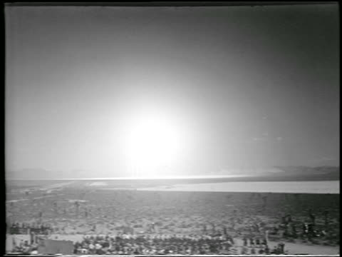 b/w 1952 wide shot long shot hbomb explosion in desert / yucca flats nevada / newsreel - 1952 stock videos and b-roll footage