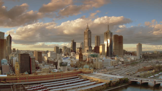 wide shot long shot slight pan melbourne skyline with traffic in foreground / victoria, australia - 1999 stock videos & royalty-free footage