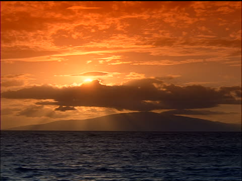 wide shot long shot sunset + clouds over silhouette of mountainous island / lanai island, hawaii - 1999 stock videos and b-roll footage