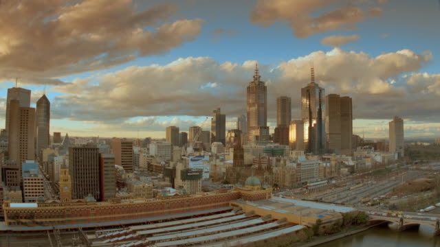 wide shot long shot time lapse clouds + traffic / melbourne skyline in background / victoria, australia - 1999 stock videos & royalty-free footage