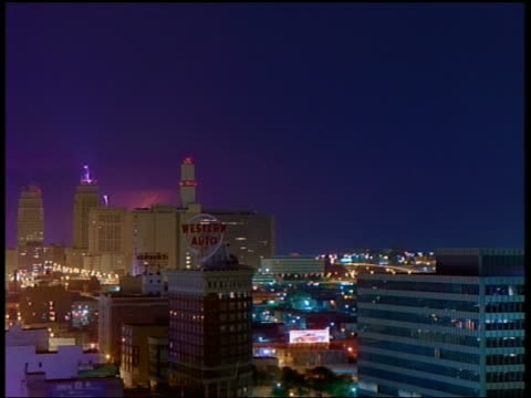 stockvideo's en b-roll-footage met wide shot long shot time lapse lightning striking behind city skyline at night (st. paul or minneapolis) / minnesota - st. paul minnesota