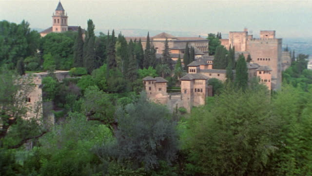 1999 wide shot lush trees surrounding the alhambra/ granada, spain - circa 13th century stock videos and b-roll footage